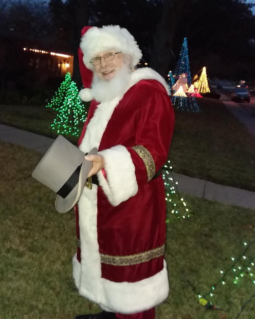 DI volunteer, David Lewis, poses as Santa Claus